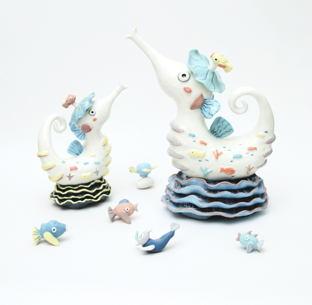 """Ingchanok S. - """"I Love Diving no.5 - Seahorse"""" 2014. Stoneware Clay, Hand Forming, engobe and high temperature firing, 30x40x45 cm. (dimensions vary with installation)"""