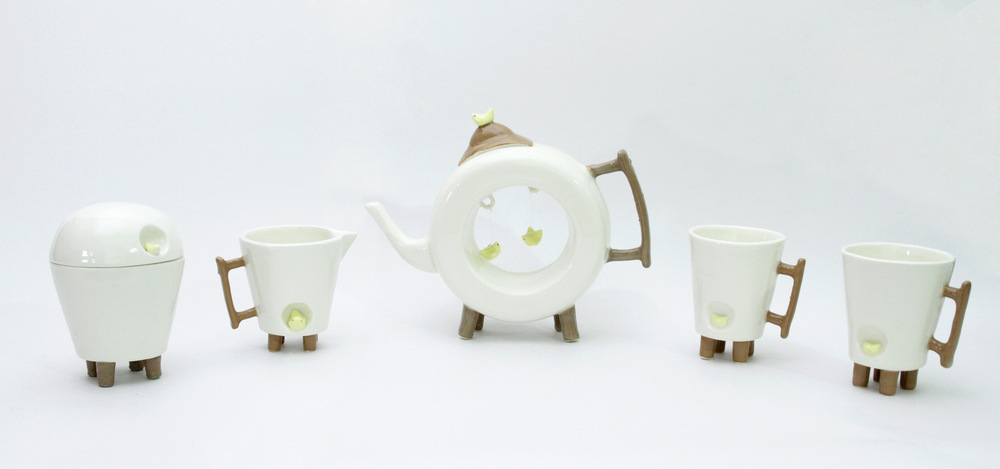 """Ingchanok S. - """"Birds in the Teas"""" 2013. Porcelain Clay, Slip Casting,Engobe and High Temperature Firing, 20x70x30 cm. (dimensions vary with installation)"""