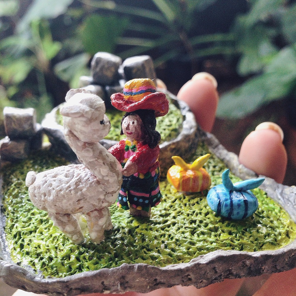 michelleflorida - Daily Life in Machu Picchu A daily scene of a Peruvian girl with her lovely llama, surrounded by stones in Machu Picchu. Clay, finished with acrylic paint. 2014.